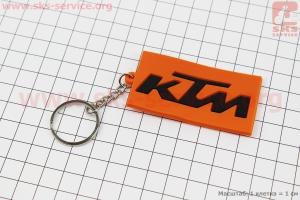 Брелок KTM, резиновый 63х34мм